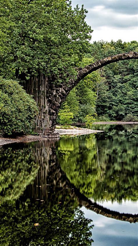bridge arch trees river reflection wallpaper