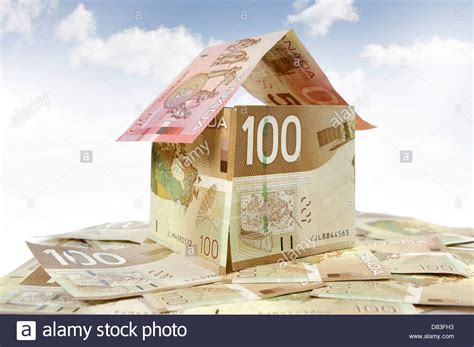 mortgage of a house model of a house made from canadian dollar bills closeup mortgage stock photo royalty