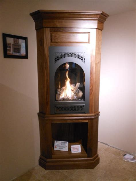avalon hideaway portrait style gas fireplace in a walnut
