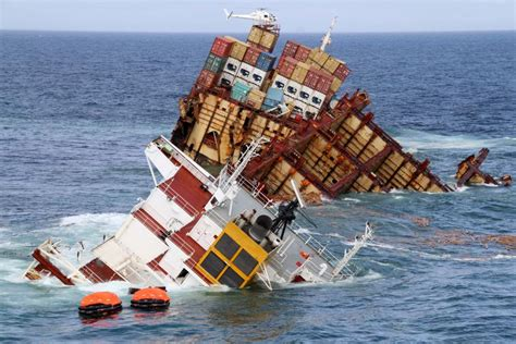 helicopter hovers above stricken container ship abc news