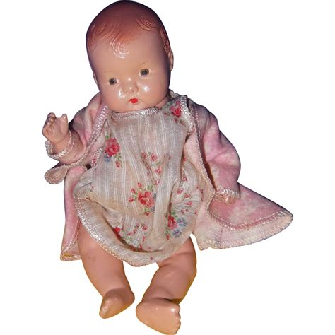 restringing a composition doll effanbee baby tinyette composition doll w rocking cradle