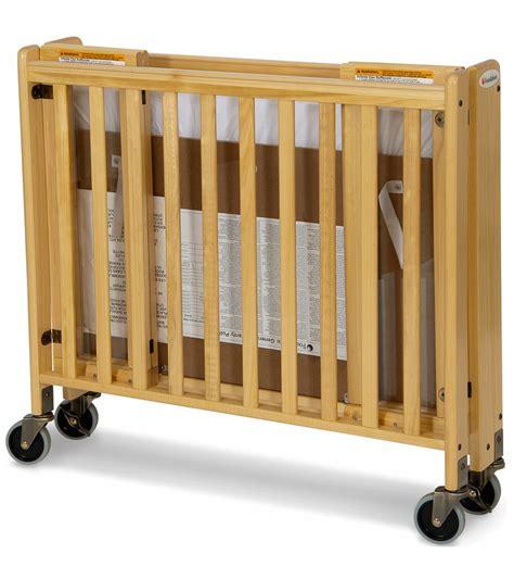 Foldable Crib by Foundations Hideaway Easyroll Wooden Folding Crib In