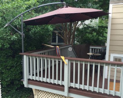 boat rail umbrella mount a cantilever umbrella outside the deck rail to save