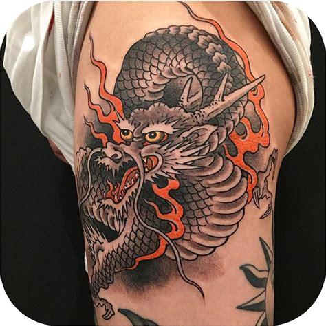 dragon tattoo okinawa instagram tattoodo on instagram awesome dragon made by ichibay