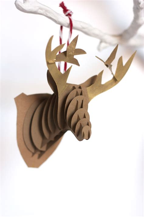 How To Make Ornaments With Paper - diy paper reindeer ornaments one litte minute