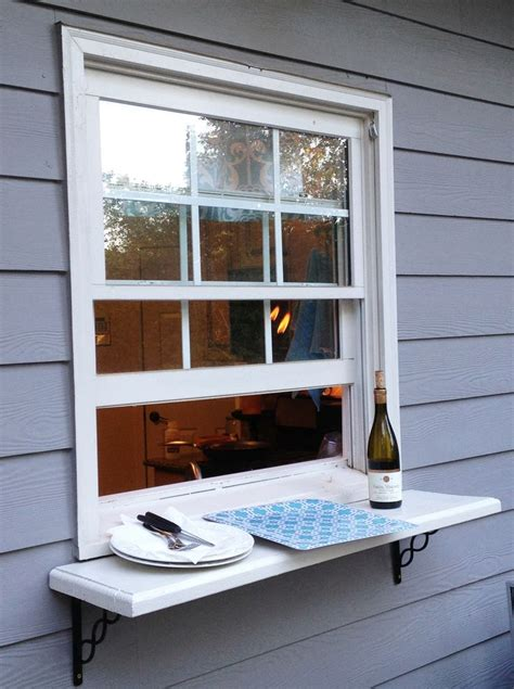 kitchen window shelf ideas deck window shelf easy pass thru to the outside from
