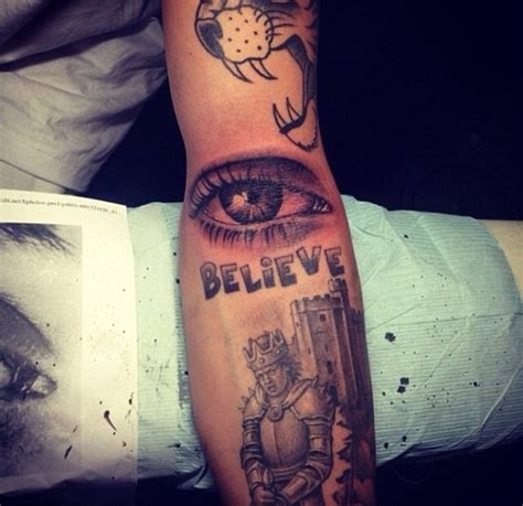 justin bieber s tattoos justin bieber s new is eye popping photo