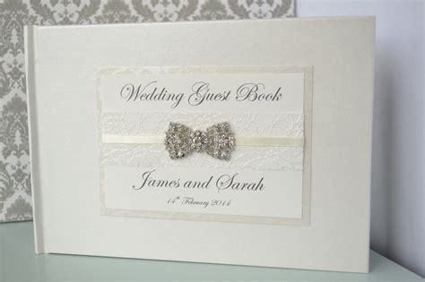 wedding guest book pictures ivory wedding guest book with beautiful lace ribbon