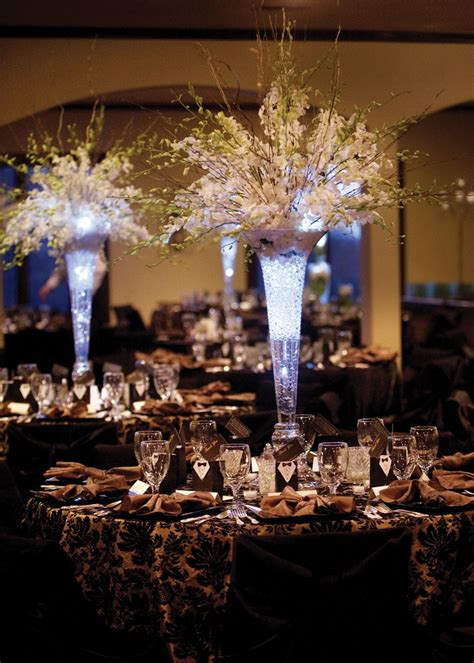 Lighting Arrangement by Tall Wedding Centerpieces