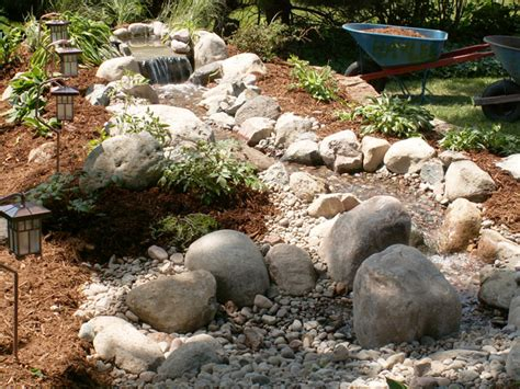 how to build a backyard stream weekend diy backyard water feature willard and may