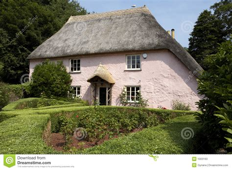 the cottage in traditional pink painted cottage stock photos