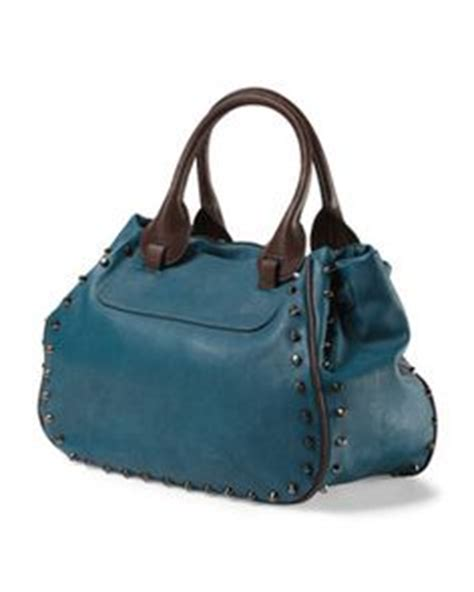Can You Guess All Four Designer Clutches by Guess April Showers Turn Lock Satchel So Many Purses So