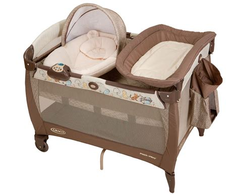 Amazon Com Graco Pack N Play Playard With Newborn Napper Winnie The Pooh Changing Table