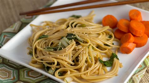 new year traditions noodles noodles with greens kitchen explorers