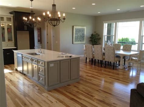 gray floors with hickory cabinets white quartz kitchen countertop with hickory wood floors