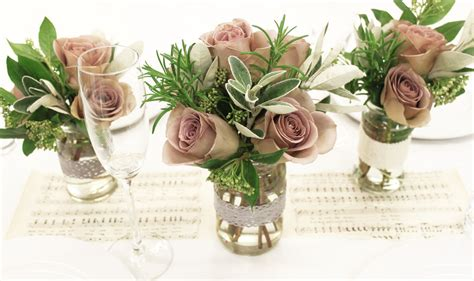 wedding table arrangements prices ways to cut cost on wedding flowers roots floral designs bristol