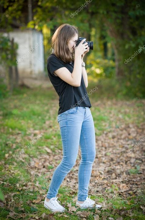 cute teenager beseoom ls attractive young taking pictures outdoors cute
