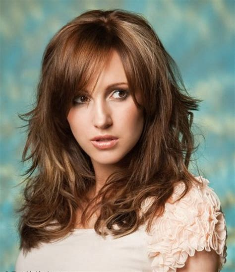 layered beachy medium length haircut wavy hairstyles with bangs wavy layered hairstyles with