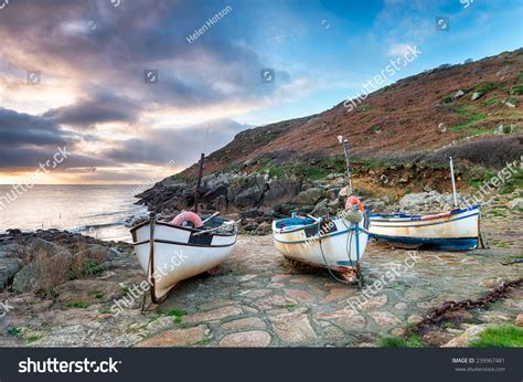 old boat on beach fishing boats on beach penberth cove stock photo 239967481