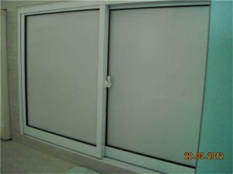 Sliding Glass Kitchen Cabinet Doors by Sliding Doors Singapore Window Grille Door