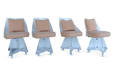 set of upholstered lucite dining chairs on casters modernism