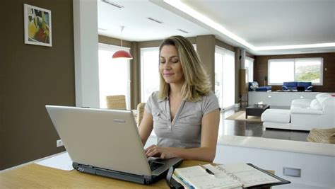 working at home on laptop computer stock footage