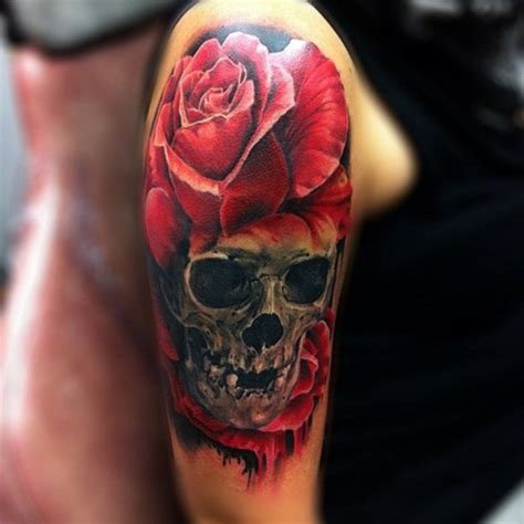 red rose tattoo meaning and skull design