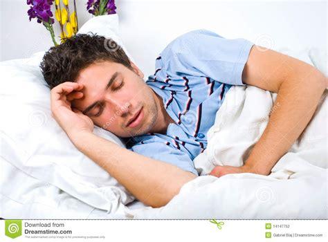 bed man young man sleeping in bed stock image cartoondealer com