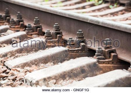 closeup of an old rusty railway track along the riverside