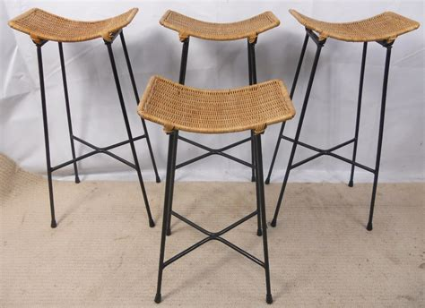 cane bar stool four 1960 s bar stools with cane seats and metal frames sold