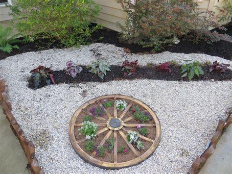 wagon wheel planter from tractorsupply com garden ideas