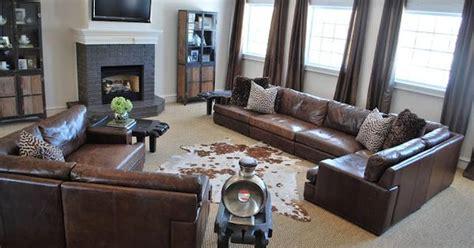 animal print rug and pillows living room family room family room living room dk brown leather sofa large jute