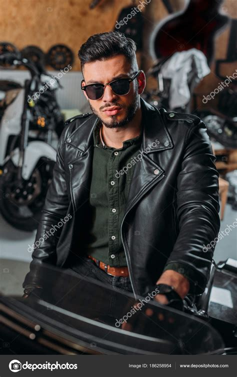 The Bad Boy In Suit By Yessy N handsome rockabilly sitting bike garage stock photo 169 vitalikradko 186258954