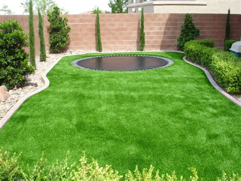 artificial grass backyard troline surrounded by sythetic turf traditional