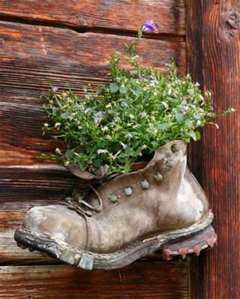 Boot Planter by Plants And Flowers In Shoes And Boots 20 Creative Garden Decorations