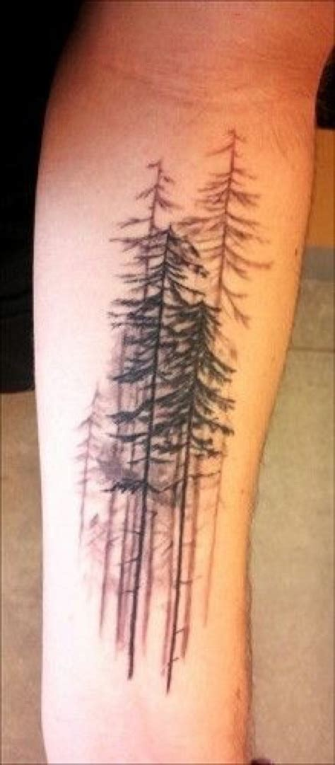 real looking tattoos realistic looking black ink forest on arm