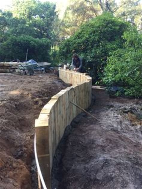 Curved Railway Sleepers by Curved Timber Retaining Wall With Vertical Railway Sleepers Great Against A Lawn Low