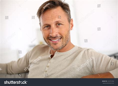 photos of 40 year old men handsome 40yearold man relaxing sofa stock photo 152731256