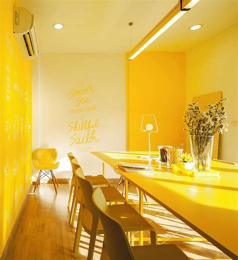 yellow interior brightly colored co working office commercial interior