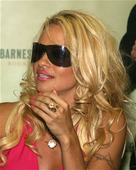 pam anderson tattoo removal barb wire tattoos