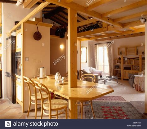 breakfast bar between kitchen and living room bentwood chairs at breakfast bar in openplan living room and kitchen stock photo royalty free