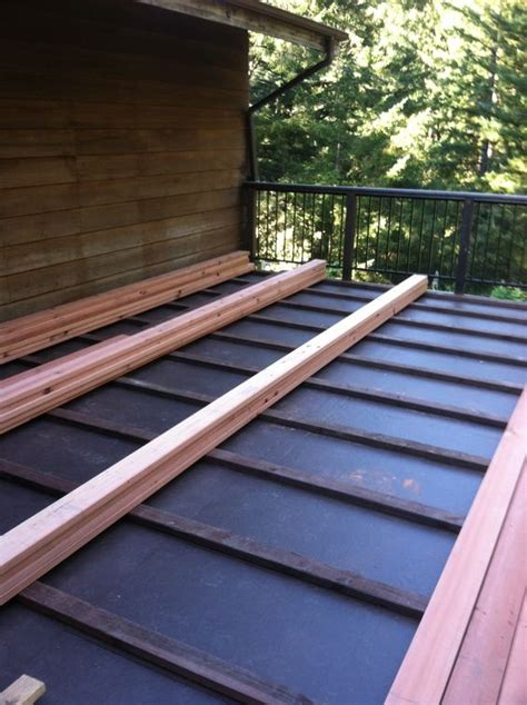 Sleeper System Deck by Ib Waterproof Membrane With 2x4 Pt Sleepers And 2x6