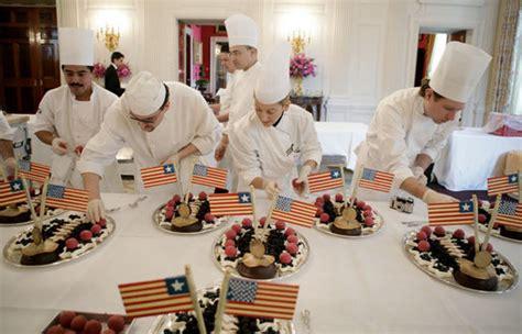 white house chef white house executive pastry chef thaddeus dubois center background supervises his