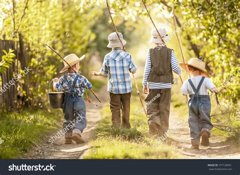 Trip Boy four boys with fishing rods go on a fishing trip on the