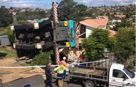 boat crash auckland crane lifting boat crashes into house in new zealand