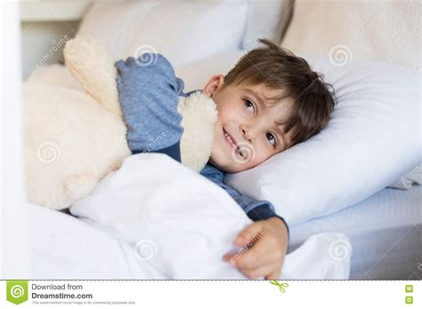 and boys in bed boy in bed stock photo image of embracing sleeping 70945546