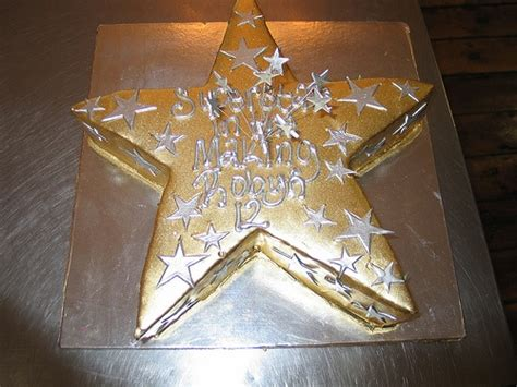 star shaped cake iced  gold chocolate ganache decorated  silver fondant stars wired