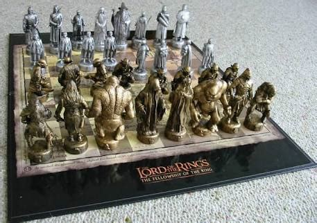 amazing Lord Of The Rings Chess Sets #1: the-Lord-of-the-rings-chess-set-with-white-and-gold-pieces-standing-on-flat-chessboard-on-the-grey-carpet.jpeg
