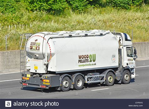 wood pellets bulk blown fuel delivery tanker lorry truck driving stock photo royalty free image
