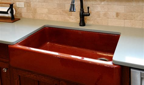 brick colored kitchen sink with rubbed finish